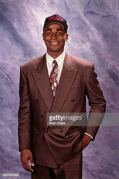 Harold Miner selected number twelve overall by the Miami Heat poses for a photo during the 1992 NBA Draft on June 24 1992 at the Veterans Memorial...