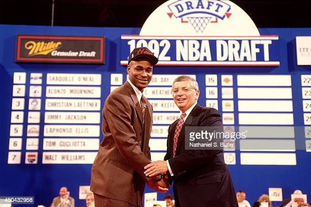 Harold Miner selected number twelve overall by the Miami Heat shakes hands with NBA Commissioner David Stern during the 1992 NBA Draft on June 24...