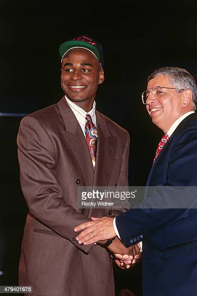Harold Miner shakes hands with NBA Commissioner David Stern after he was selected number twelve overall by the Miami Heat during the 1992 NBA Draft...
