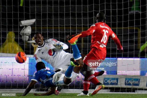 Harold Mosquera of Millonarios heads the ball to score the second goal of his team during a match between Millonarios and America de Cali as part of...