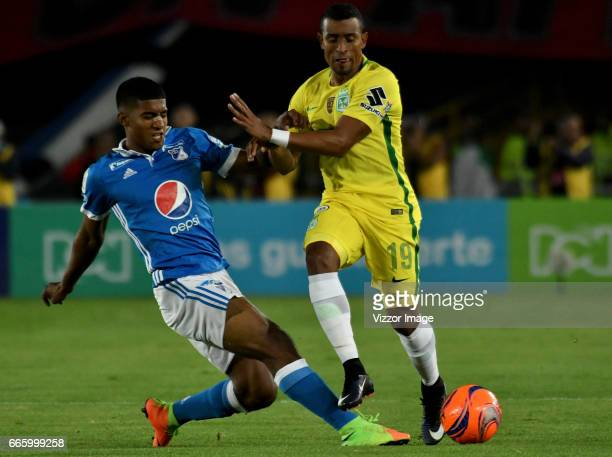 Harold Mosquera of Millonarios vies for the ball with Farid Diaz of Atletico Nacional during the match between Millonarios and Atletico Nacional as...