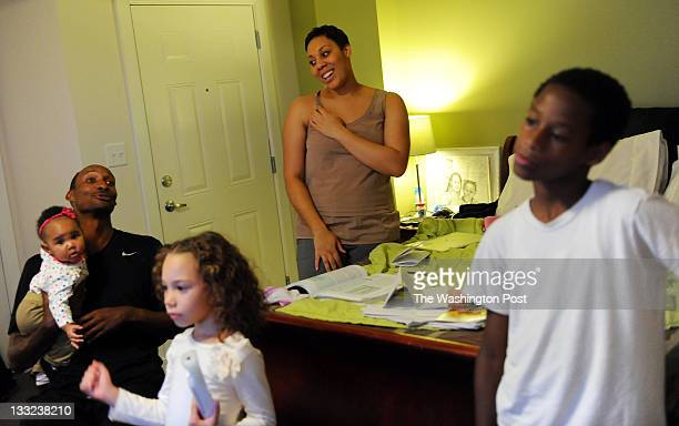 Harold Peanut Hill prepares to study with his daughter Chamilla Hill at his apartment on October 4 2011 in Washington DC Harold Hill is seen holding...