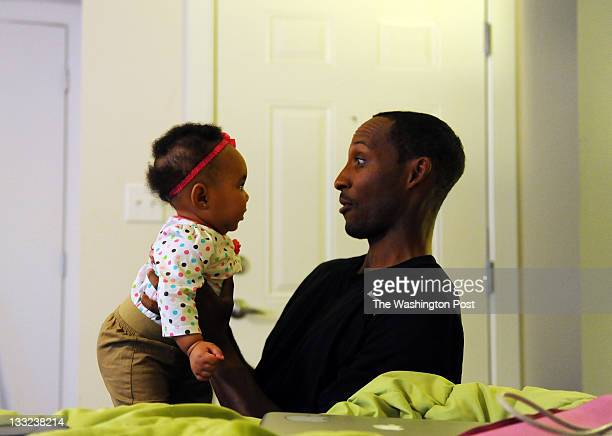 Harold PNut Hill plays with his 5monthold granddaughter Jamilla Hill at his apartment