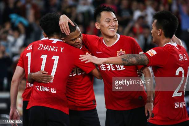 Harold Preciado of Shenzhen FC celebrates with teammates after scoring a goal during the first round match of 2019 Chinese Football Association Super...