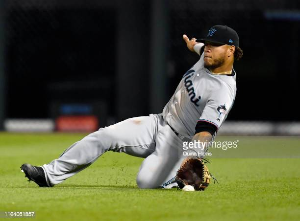 Harold Ramirez of the Miami Marlins can't make the catch in the ninth inning against the Chicago White Sox at Guaranteed Rate Field on July 24 2019...