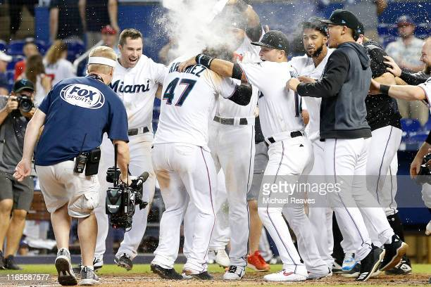 Harold Ramirez of the Miami Marlins celebrates after hitting a walkoff solo home run in the twelfth inning to defeat the Minnesota Twins 54 at...