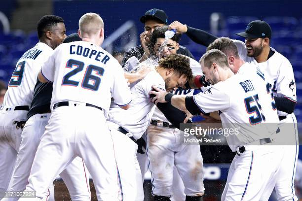 Harold Ramirez of the Miami Marlins celebrates with teammates after hitting a walk-off home run in the twelfth inning against the Cincinnati Reds at...
