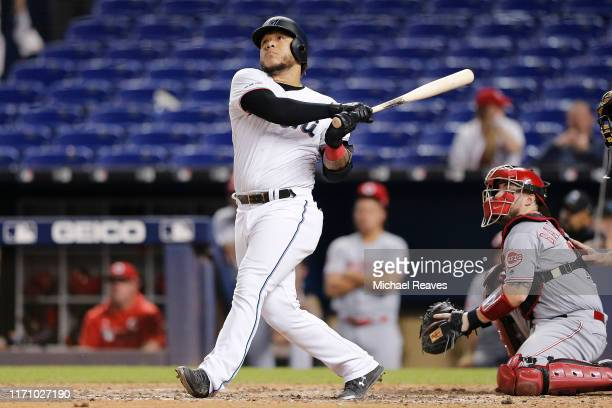 Harold Ramirez of the Miami Marlins hits a solo walk-off home run in the twelfth inning against the Cincinnati Reds at Marlins Park on August 29,...