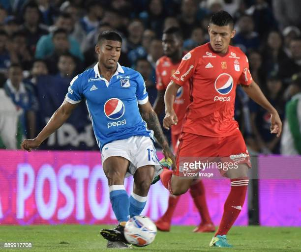 Harold Santiago Mosquera of Millonarios fights for the ball with Jhonny Vasquez of America de Cali during the second leg match between Millonarios...