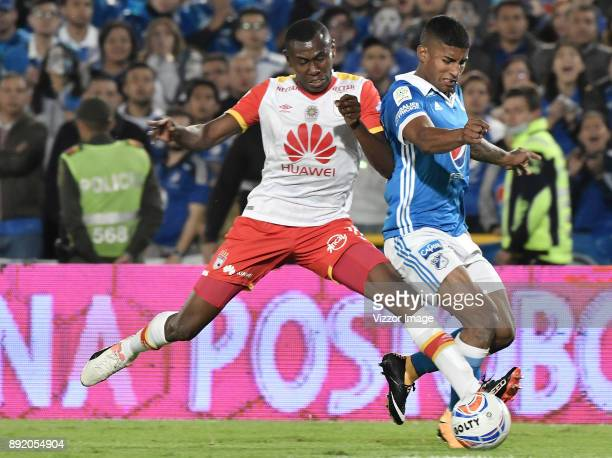 Harold Santiago Mosquera of Millonarios fights for the ball with Hector Urrego of Independiente Santa Fe during the first leg match between...