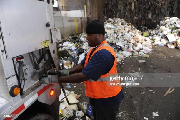 Harold Taylor a Fairfax County employee finishes dumping trash at the COVANTA Fairfax Energy/Resource Recovery Facility on May 14 in Lorton VA...