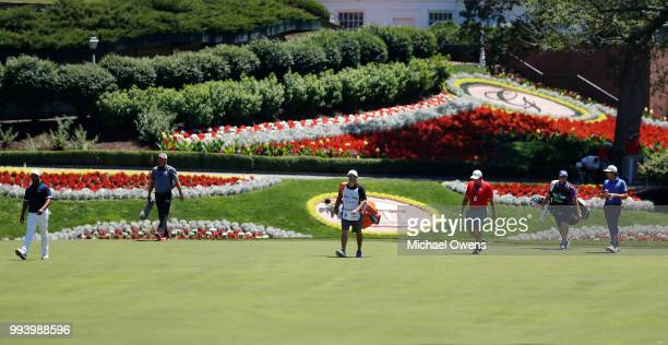 Harold Varner III and Kelly Kraft walk to their second shots on the first hole during the final round of A Military Tribute At The Greenbrier held at...