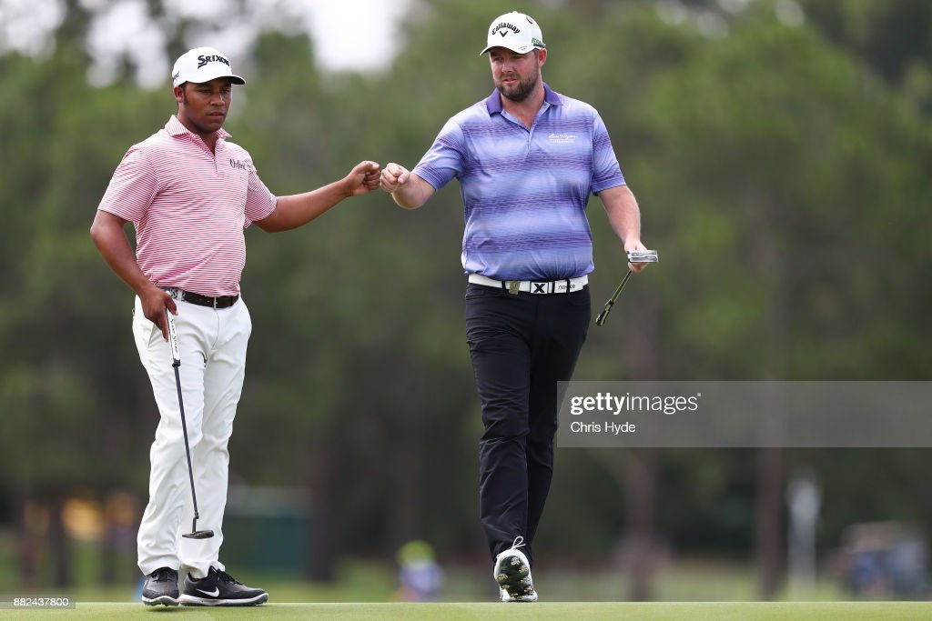 Harold Varner III and Marc Leishman celebrate a birdie put on the 8th hole during day one of the 2017 Australian PGA Championship at Royal Pines Resort on November 30, 2017 in Gold Coast, Australia.