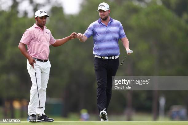 Harold Varner III and Marc Leishman celebrate a birdie put on the 8th hole during day one of the 2017 Australian PGA Championship at Royal Pines...
