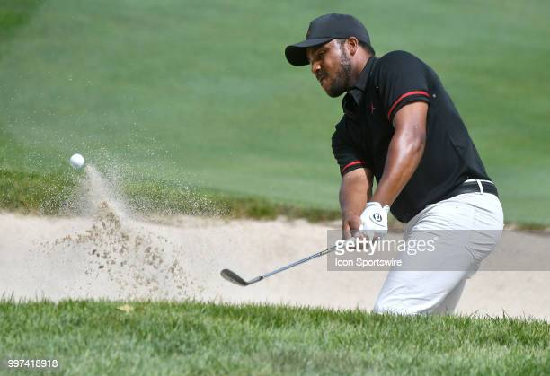 Harold Varner III hits out of a sand trap on the hole during the first round of the John Deere Classic on July 12 at TPC Deere Run Silvis IL