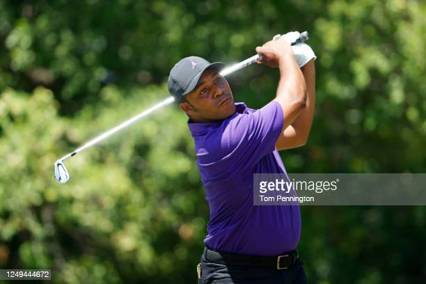 Harold Varner III of the United States plays his shot from the ninth tee during the third round of the Charles Schwab Challenge on June 13, 2020 at...