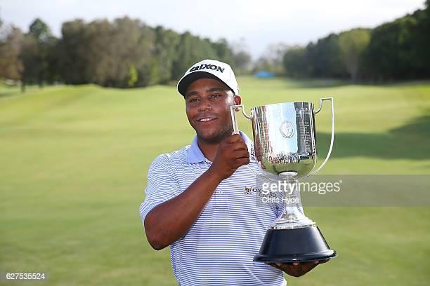 Harold Varner III of the USA celebrates after winning the Joe Kirkwood trophy on day four of the 2016 Australian PGA Championship at RACV Royal Pines...