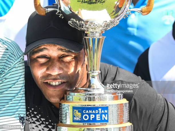 Harold Varner III poses with the tournament trophy during the practice rounds at the RBC Canadian Open at Glen Abbey Golf Club on July 25 2018 in...