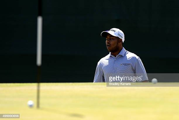 Harold Varner of the USA reacts after his ball narrowly misses the hole on the 18th hole during day three of the 2015 Australian PGA Championship at...