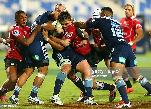 Harold Vorster of the Lions is tackled during the round four Super Rugby match between the Blues and the Lions at QBE Stadium on March 7 2015 in...