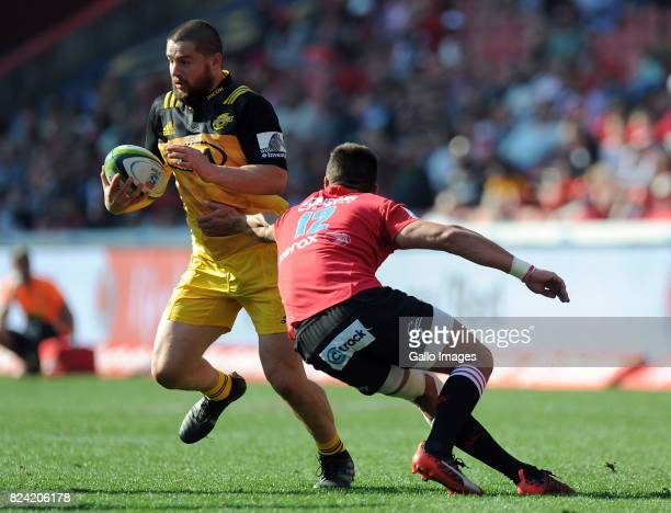 Harold Voster and Elton Jantjies of Lions in action with Dane Coles of Hurricane during the Super Rugby Semi Final match between Emirates Lions and...