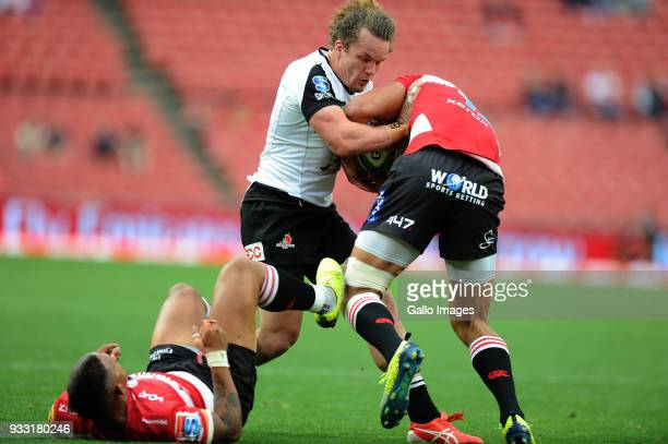Harold Voster and Elton Jantjies of Lions in action with Michael Little of Sunwolves during the Super Rugby match between Emirates Lions and...