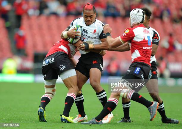Harold Voster and Len massyn of Lions in action with Lemeki Lomano of Sunwolves during the Super Rugby match between Emirates Lions and Sunwolves at...