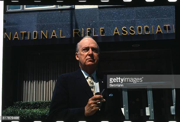 Harold W Glassen President of the National Rifle Association is shown here in front of the association's headquarters