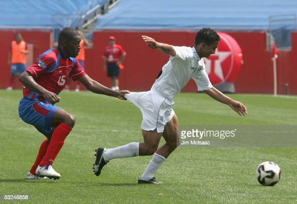 Harold Wallace of Costa Rica pulls on the shorts of Mario Berrios of Honduras during the CONCACAF quarterfinal match on July 16 2005 at Gillette...