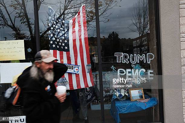 Harold who is homeless walks downtown past a campaign sign on October 24 2016 in East Liverpool Ohio East Liverpool once prosperous from steel mills...
