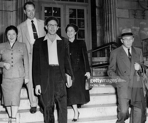 NOV 22 1954 NOV 23 1954 Harold Zepelin leaves the postoffice building with his family and friends after his father Moses Zepelin of 1310 Utica posted...