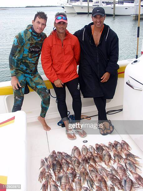 Harolf Dean from left Raul Lizaso and Frank Vasallo all members of South Florida Freedivers pose for portrait next to their catch of 47 dead lionfish...