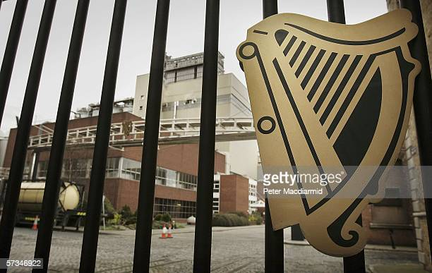 A harp logo is displayed on the gates of the Guinness brewery on April 16 2006 in Dublin Ireland