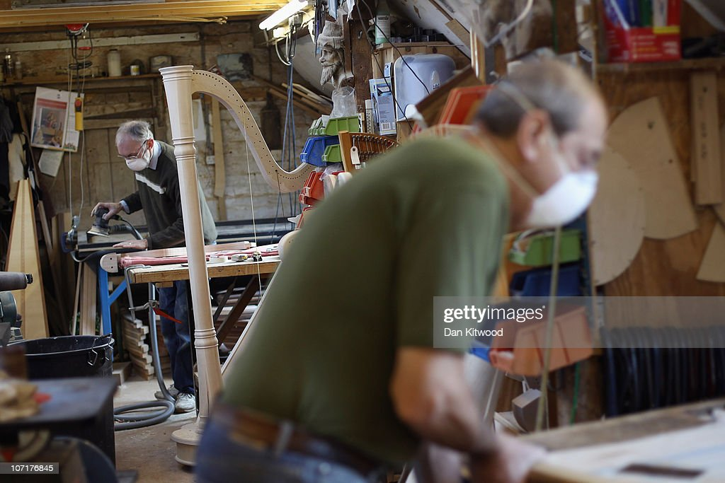 Harp makers work in the workshop at Pilgrim Harps on