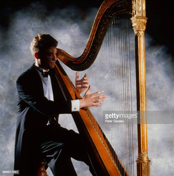 harp player - tail coat stock pictures, royalty-free photos & images