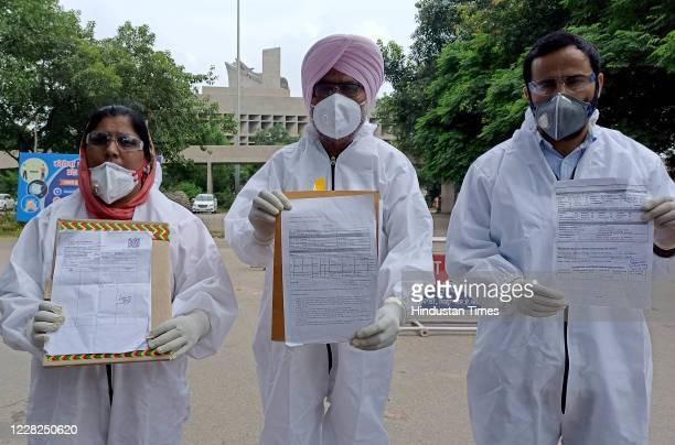 Harpal Cheema Leader of Opposition with MLA Sarabjit Karu and MLA Meet Hayer holding Covid19 negative test reports outside Punjab Bhawan in Sector 3...