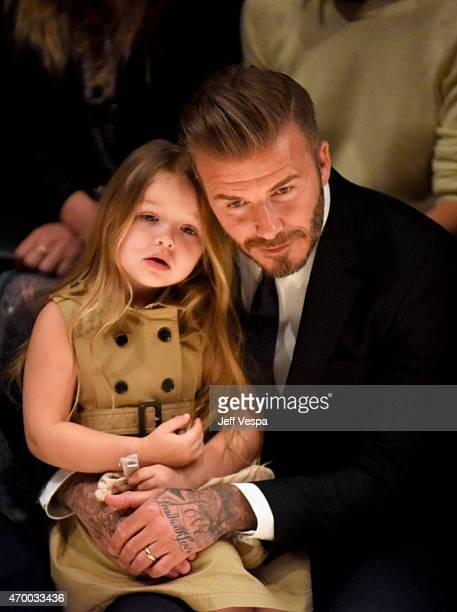 Harper Beckham and David Beckham attend the Burberry 'London in Los Angeles' event at Griffith Observatory on April 16 2015 in Los Angeles California