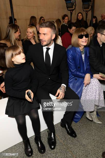 Harper Beckham David Beckham and Anna Wintour attend the Victoria Beckham show during London Fashion Week February 2019 on February 17 2019 in London...