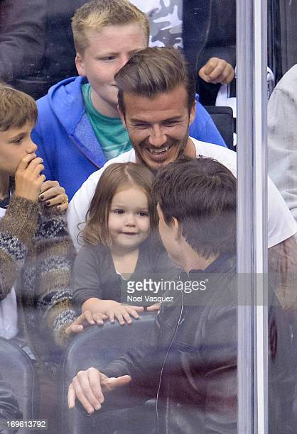 Harper Beckham David Beckham and Tom Cruise attend an NHL playoff game between the San Jose Sharks and the Los Angeles Kings at Staples Center on May...