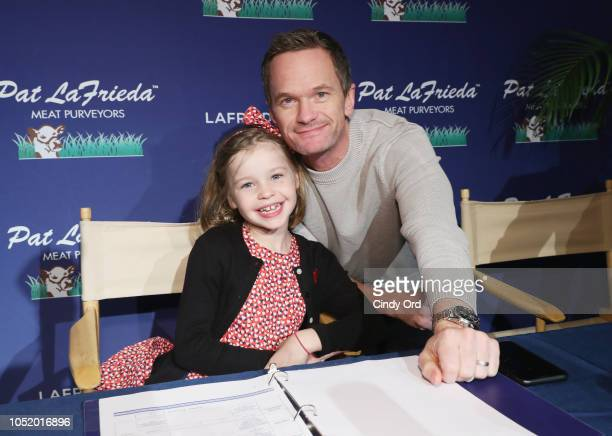 Harper Grace Burtka-Harris and Neil Patrick Harris attend the Food Network & Cooking Channel New York City Wine & Food Festival presented by Capital...