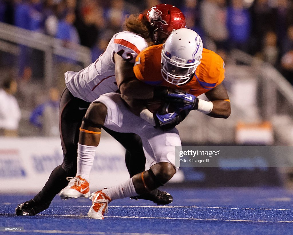 D.J. Harper #7 of the Boise State Broncos is brought down by Jake Fely #42 of the San Diego State Aztecs at Bronco Stadium on November 3, 2012 in Boise, Idaho.