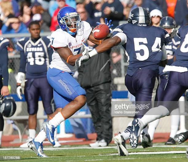 DJ Harper of the Boise State Broncos takes a pitch from quarterback Joe Southwick against the University of Nevada during a college football game at...