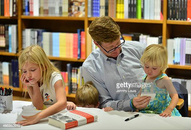 Harper Petitgout Owen Kennedy Patrick Kennedy and daughter Nora Kennedy sign copy of his book A Common Struggle A Personal Journey Throught The Past...