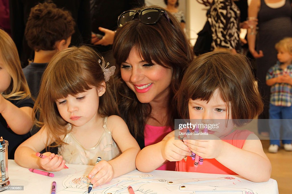 Harper Renn Smith (L) and mother Tiffani Thiessen (C) attend Oscar de le Renta and author Kelly Florio Kasouf invite children to shop the Spring 2013 Collections and Limited Edition 'Sophie Party Dress' at Oscar de La Renta Boutique on April 23, 2013 in West Hollywood, California.