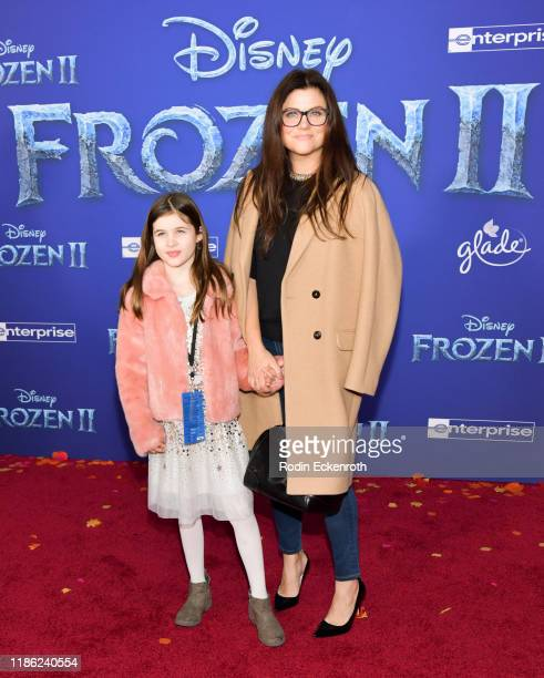 Harper Renn Smith and Tiffani Thiessen attend the Premiere of Disney's Frozen 2 at Dolby Theatre on November 07 2019 in Hollywood California