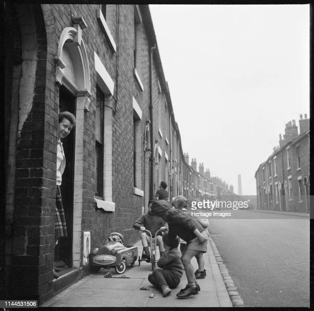 Harper Street Middleport Burslem StokeonTrent 19651968 Children playing on the pavement outside a house on the north side of Harper Street with the...