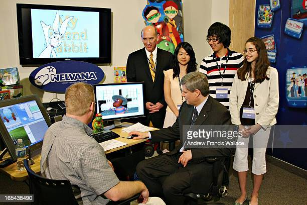 HARPER04/18/08Prime Minister Stephen Harper trys out the animation software at Nelvana Animation Studio in Toronto April 18 2008 Seated is animation...