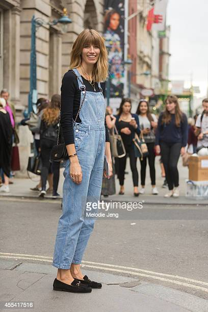 Harper's Bazaar Germany Style Editor Veronika Heilbrunner wears Calvin Klein overalls a Mads N¿rgaard top Gucci loafers and a Chanel bag on Day 2 of...