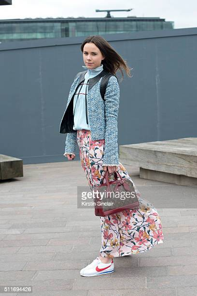 Harperâs Bazaar junior fashion editor Florrie Thomas wears a Free People skirt Adidas zip jacket Louis Vuitton jacket and bag and Nike trainers on...