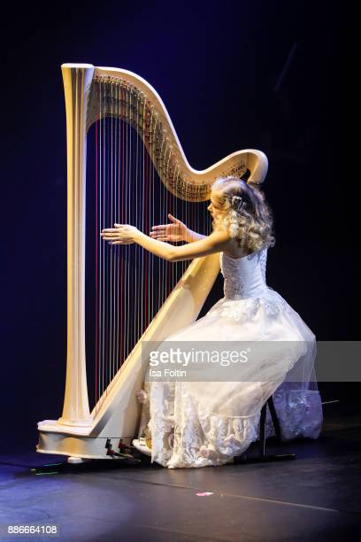 Harpist Alisa Sadikova performs live on stage during the Royal Christmas Gala at Tempodrom on December 5 2017 in Berlin Germany